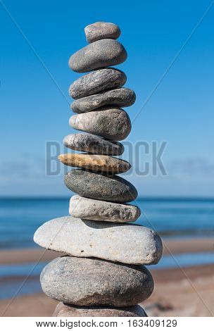 Stones pyramid on beach symbolizing harmony, balance