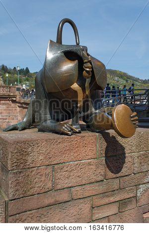 HEIDELBERG, GERMANY - MAR 29, 2014: Bronze sculpture of a monkey on the old bridge in Heidelberg.