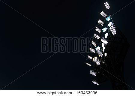 Lighting tower of stadium on the dark or night sky background.
