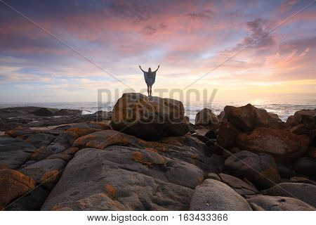 Rocky Landscape And Ocean At Sunrise