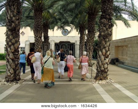 Tourists/Women Entering The Baptismal Entrance In Israel