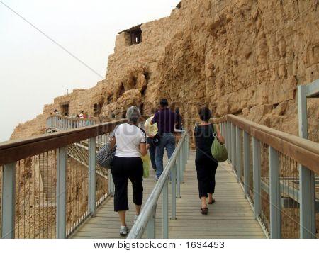 Tourists On An Elevated Walkway To Enter Massada