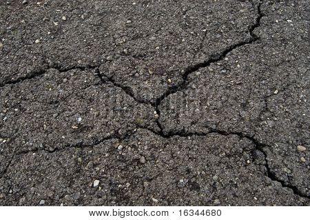 cracked road asphalt close up