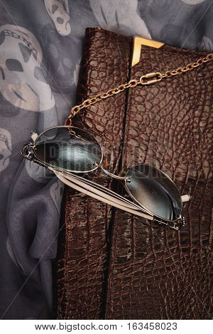 stylish accessories. sunglasses with clutch and scarf