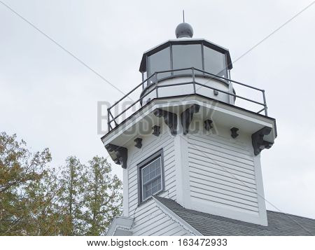 Jutting into Grand Traverse Bay, an arm of Lake Michigan, is Mission Point where this lighthouse was built in 1870. It is located on the 45th parallel midway between the equator and the North Pole.