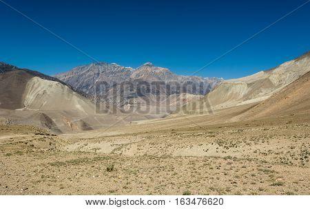 Arid mountain wasteland. Borderland between Mustang and Muktinath in Nepal.