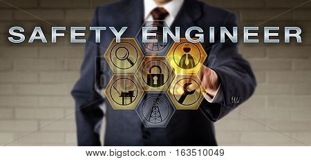 Management executive highlighting SAFETY ENGINEER on an interactive control monitor. Oil and gas industry metaphor for a project manager ensuring engineering outputs and meeting safety requirements.
