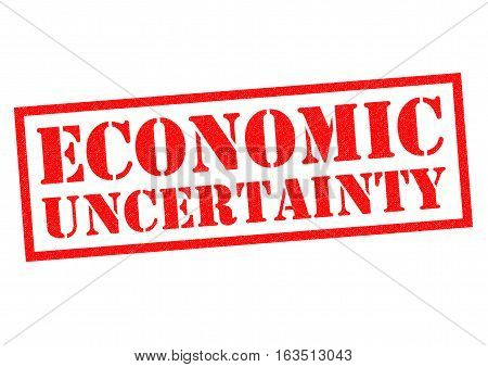 ECONOMIC UNCERTAINTY red Rubber Stamp over a white background.