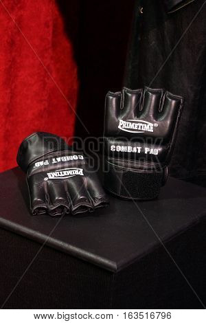 SAN JOSE - MARCH 28: WWE Legend Undertakers Primetime Combat Pad Gloves from Wrestlemania 30 where his 21-0 record at the event was broken by Brock Lesner at WWE Axxess event at the McEnery Convention Center in San Jose California on March 28 2015.