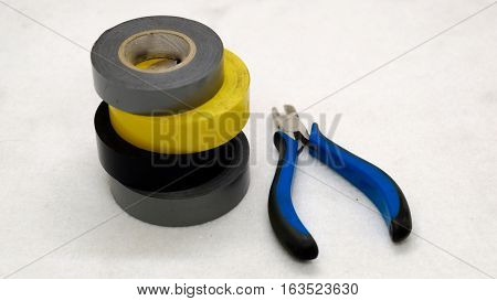 Tools for the electrician. duct tape and pliers