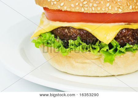 cheeseburger on plate isolated on white
