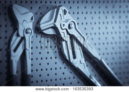 Close up shot of two plumber pliers.