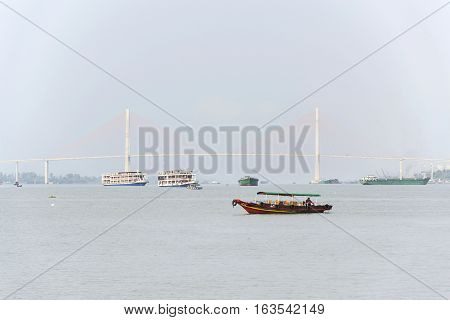 My Tho, Vietnam - February 14: Boat With Soil Floating On Mekong With Rach Mieu Bridge On February 1