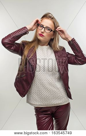 Student Girl In Glasses And Stylish Spring Casual Clothing.  In Leather Jacket Smiles  She Has Good