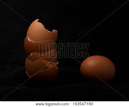 Brown egg isolated over black background breakfast, healthy, shell, protein