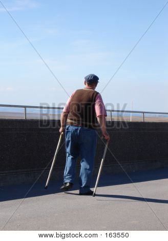 Old Man With Walking Sticks