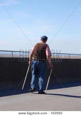 Old Man With Walking Sticks