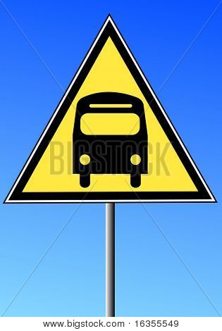 yellow triangle sign with a bus against a blue sky  - transportation concept