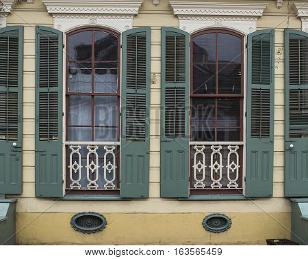A tight view of windows on a home in the French Quarter of New Orleans in Louisiana.