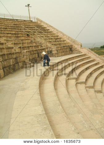 Tired Tourist/Woman Climbing Stairs Of Roman Theatre