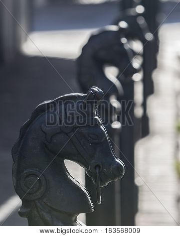 A row of horse posts / horse ties along a sidewalk in the French Quarter of New Orleans