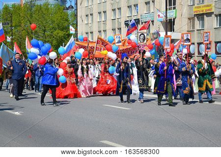 People in national suits participate in demonstration in honor of the Victory Day on May 9 2016. Tyumen Russia
