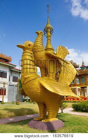 Golden bird statue in Wat Thai Wat Tha Na Ram temple in Mae sot, Tak, Thailand