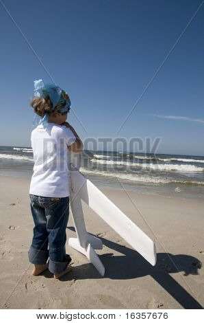 Little girl playing with plane model