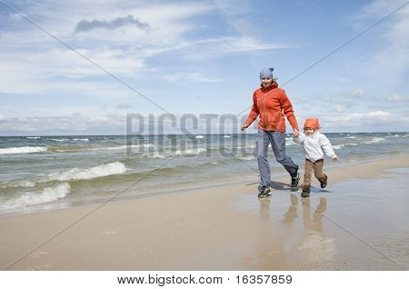 Mother chasing daughter through the beach