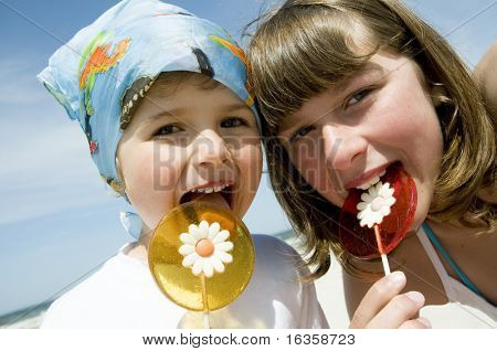 Sweet girls with lollipop