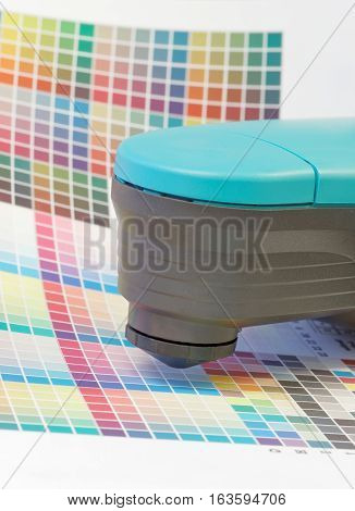 Spectrometer used for proofing on a leaf of the multi color test print in a pre-press workshop