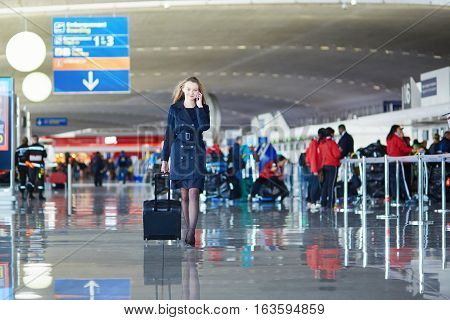 Young Female Traveler In International Airport