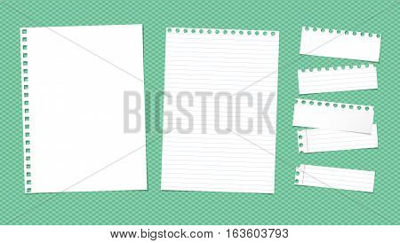 White ruled torn note, notebook, copybook paper sheets stuck on green squared pattern.