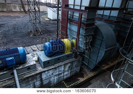 two large electric motors used to drive the fan exhaust
