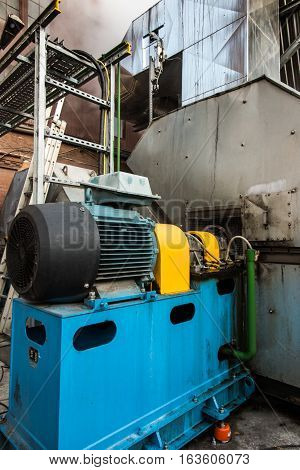 large electric motor used to drive the fan exhaust