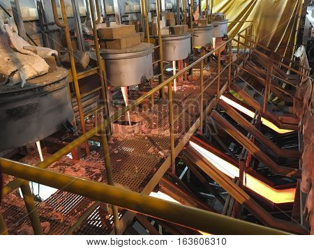 production of enamel, the streams of molten glass at the installation