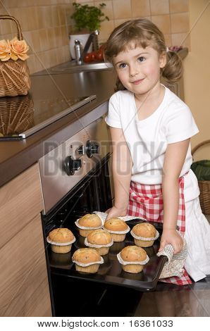 Cute girl baking muffins