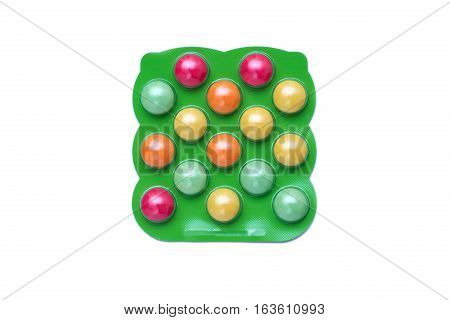 Colorful Pills For Kids In The Plastic Packaging Isolated On White Background.