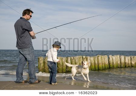 Family fishing with dog