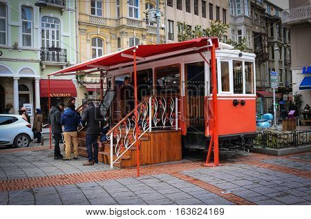 Istanbul Turkey - February 16 2016: Streetcar turned into a restaurant selling snacks in front of Galata tower in Istanbul Turkey