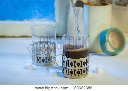 Hot Coffee Pot And Cup With Spoons By Frozen Window