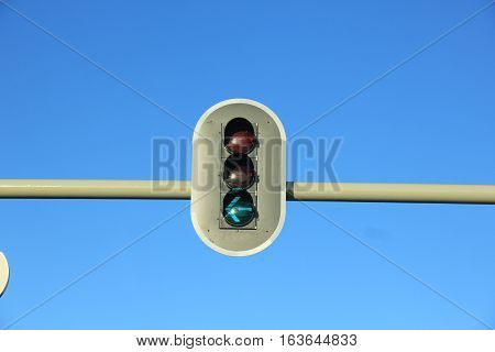 Traffic lights in a clear blue sky