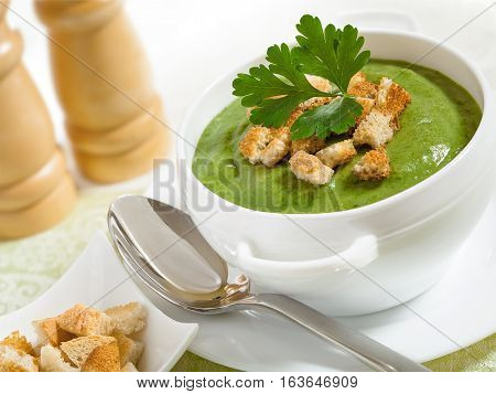 Cream soup and dried crusts on the tablecloth studio shot