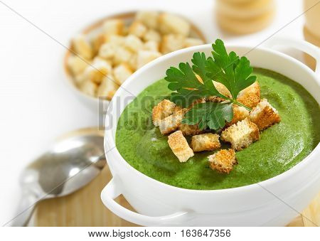 Cream soup and dried crusts studio shot white background isolated