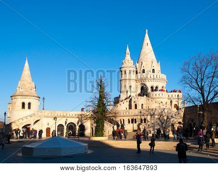 Typical light stone rounded fairy tale towers of Fisherman's Bastion, aka Halaszbastya, on a terrace in neo-Gothic and neo-Romanesque architectural style. Lookout turrets are situated on a Buda bank side of Danube River in Budapest, capital city of Hungar