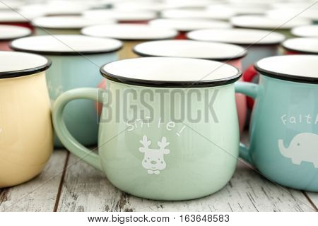 Colorful Ceramic Mugs with Enamel Look on white