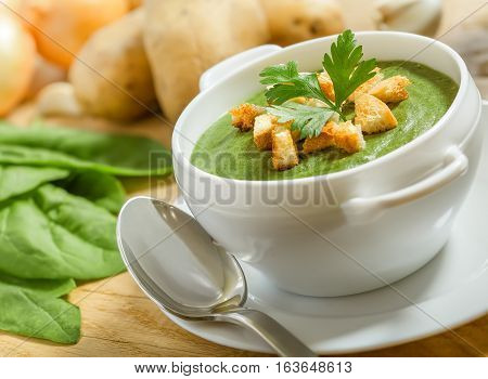 Cream soup with dried crusts and ingridients on the table studio shot