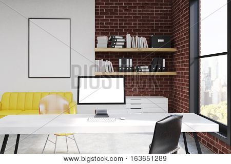 Computer Monitor On Desk In Office With Sofa