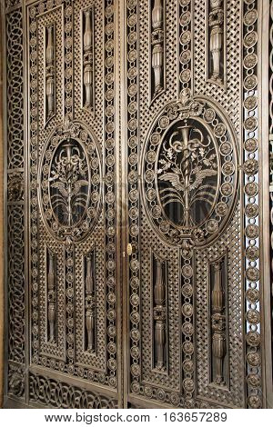 Gorgeous image of elaborate metal doors, with impressive scrollwork.