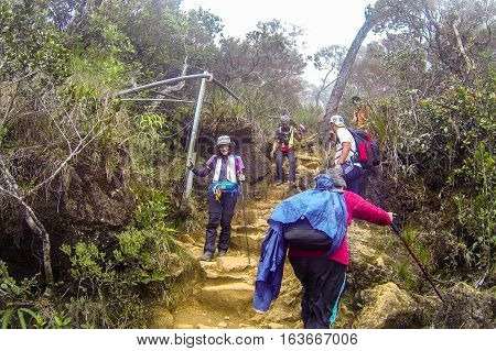 Ranau,Sabah,Malaysia-Apr 29,2014:Climbers seen at Timpohon trail from Laban Rata of Mount Kinabalu.The best time to climb Mt Kinabalu is between March & August which are the dry season of Sabah,Borneo